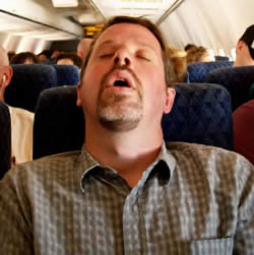 funny snoring - man snoring in the airplane